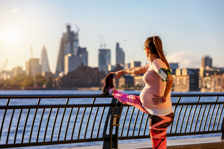 Pregnant woman safely stretching in London